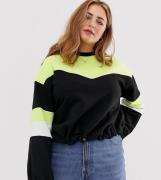 Sudadera con diseño colour block neón y cordón en el bajo de ASOS DESI...